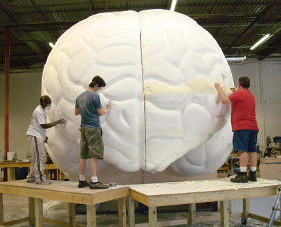 Exhibit artists sculpting a 16-foot by 16-foot human brain